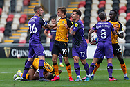 Tempers flare up between Newport County's Scott Twine (19) and Tranmere Rover's Peter Clarke (26) during the EFL Sky Bet League 2 match between Newport County and Tranmere Rovers at Rodney Parade, Newport, Wales on 17 October 2020.