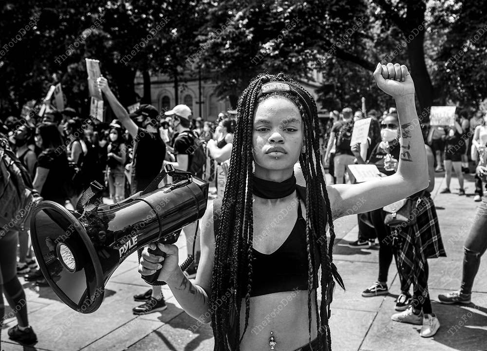 """NEW YORK, NEW YORK: Livia Rose Johnson, 20, of New York and march march organizer stands for a portrait with her bullhorn in her hand at New York City Hall during a Justice for George Floyd protest and rally in New York, New York on Thursday, June 4, 2020. Johnson says """"I refuse to see any generations younger than me march for he same thing.""""Tens of thousands of people protested across the United States and in major world cities for another night of outrage over police brutality intensified over the death ofGeorge Floyd. (Brian Branch-Price/TheFotoDesk)."""