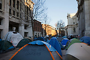 A tent amongst tents with a message; Bankers are the real looters. The camp Occupy London Stock Exchange outside St Paul's Cathedral was in the morning served with eviction notice after months of legal battle with the Corporation of London. The site was occupied Oct 15th.