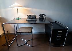 Desk inside Bauhaus style Haus Feininger, one of the Meisterhauser  in Dessau, Germany.