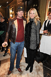 NOELLE RENO and SCOT YOUNG at a Cocktail party to celebrate the opening of the new Miu Miu boutique, 150 New Bond Street, London hosted by Miuccia Prada and Patrizio Bertelli on 3rd December 2010.