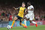 Hector Bellerin of Arsenal (l) and Adama Traore of FC Basel both compete for the ball. UEFA Champions league group A match, Arsenal v FC Basel at the Emirates Stadium in London on Wednesday 28th September 2016.<br /> pic by John Patrick Fletcher, Andrew Orchard sports photography.