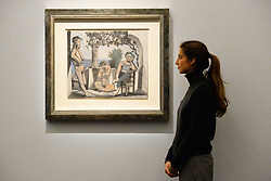 A visitor looks at Le Repos du Saune by Pablo Picasso during a photo call for Sotheby's Impressionist, Modern Art and Surrealist Art sales, in London.