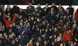 07 January 2018 FA Cup 3rd round Nottingham - Nottingham Forest v Arsenal - Arsenal manager Arsene Wenger looking miserable in the stands as the Forest fans around him celebrate their fourth goal.<br /> (photo by Mark Leech)