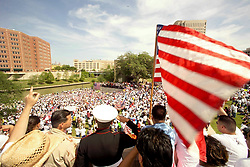 Stock photo of  US Army Staff Sgt. Shannon Arteche salutes the crowd at Allen's Landing in downtown Houston during the protests for the rights of immigrants.
