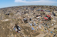An aerial photo of the tornado damage in Oklahoma City, Oklahoma May 22, 2013.  Rescue workers with sniffer dogs picked through the ruins on Wednesday to ensure no survivors remained buried after a deadly tornado left thousands homeless and trying to salvage what was left of their belongings. Curvature of horizon in the photo is due to an ultra-wide angle lens.  REUTERS/Rick Wilking (UNITED STATES)