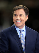 Sports announcer Bob Costas smiles on the field level sideline television set before the NFL week 8 regular season football game against the Green Bay Packers on Sunday, Oct. 26, 2014 in New Orleans. The Saints won the game 44-23. ©Paul Anthony Spinelli