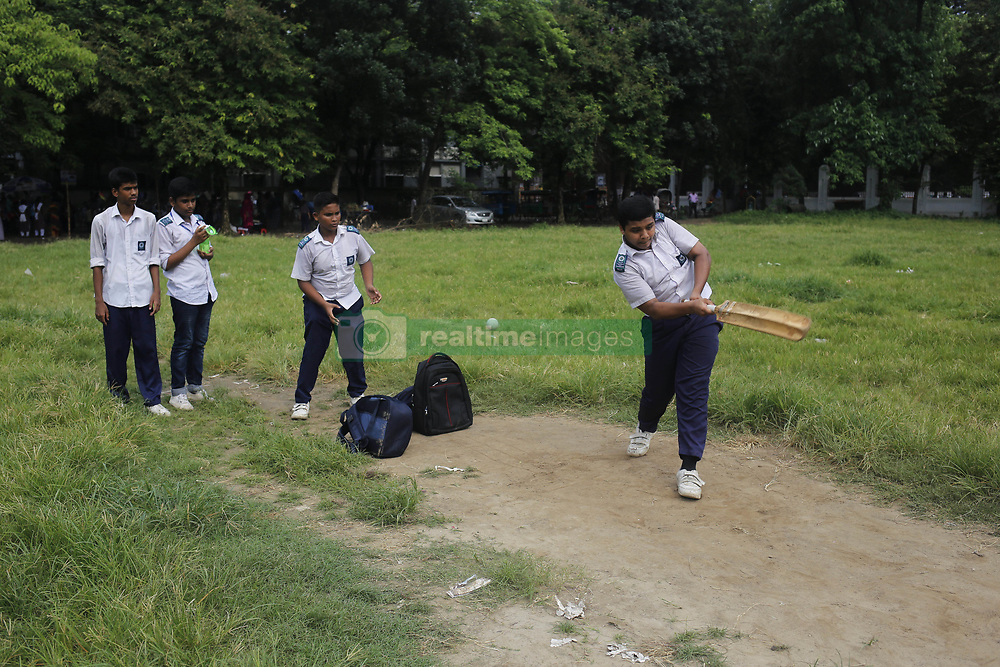 June 27, 2019 - Dhaka, bangladesh - School boys play cricket after school during Cricket World Cup session near Dhaka University area. Now a day, cricket is a popular sport on youth in the country. (Credit Image: © MD Mehedi Hasan/ZUMA Wire)