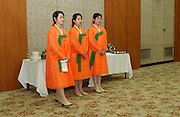 Government employed waitresses at official dinner in Pyongyang.