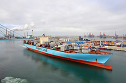 """The """"Elly Maersk"""" departs from the APM Terminal at the Port of Rotterdam, in Rotterdam, the Netherlands. The """"Elly Maersk"""" one of eight PS-class container ships in the Maersk Line fleet,  and is one of the largest container vessels in the world. With an overall length of 397 meters and a width of 56 meters, it is capable of carrying 11,000 TEU (Twenty foot Equivalent Unit - a 20 foot long container). The Maersk Line is a division of the A.P. Moller - Maersk Group. (Photo © Jock Fistick)"""