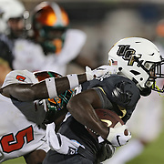 ORLANDO, FL - AUGUST 29: Adrian Killins Jr. #9 of the UCF Knights is tackled by Markquese Bell #5 of the Florida A&M Rattlers during a NCAA football game on August 29 2019 in Orlando, Florida. (Photo by Alex Menendez/Getty Images) *** Local Caption *** Adrian Killins Jr.; Markquese Bell