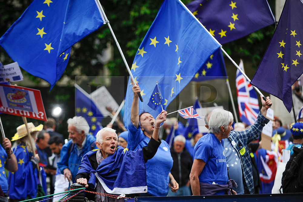 © Licensed to London News Pictures. 12/06/2018. LONDON, UK.  Anti-Brexit protesters demonstrate waving European flags outside the Houses of Parliament as MPs begin two days of debate and vote on amendments to the EU Withdrawal Bill.  Photo credit: Stephen Chung/LNP
