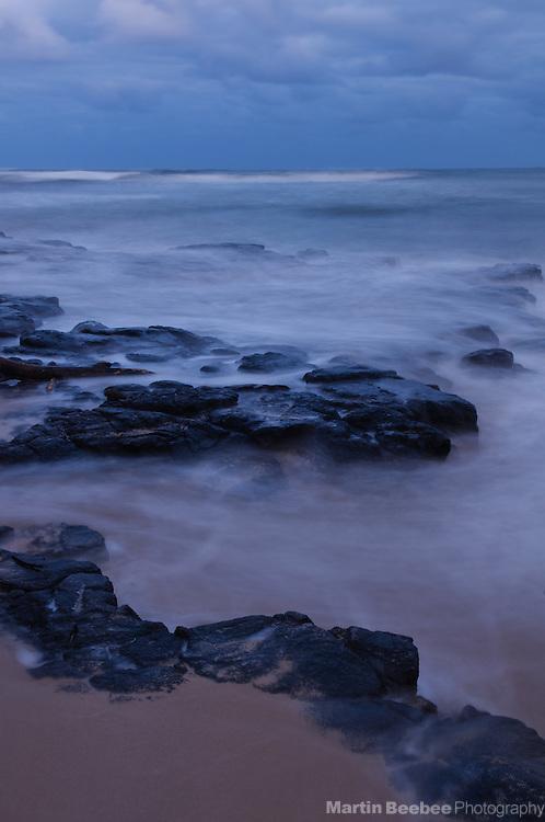 Incoming waves as dusk, Kauai, Hawaii