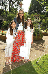 Model LISA BUTCHER and her daughters, left AMBER DANOSO and right, OLIVIA DANOSO at a children's party to celebrate the launch of the new Baby Dior store in London - held in Eaton Square, London on 8th June 2005.<br />