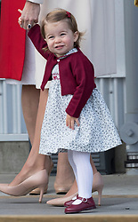 The Duchess of Cambridge and Princess Charlotte after a ceremony to mark their departure at Victoria Harbour seaplane terminal in Victoria during the Royal Tour of Canada.