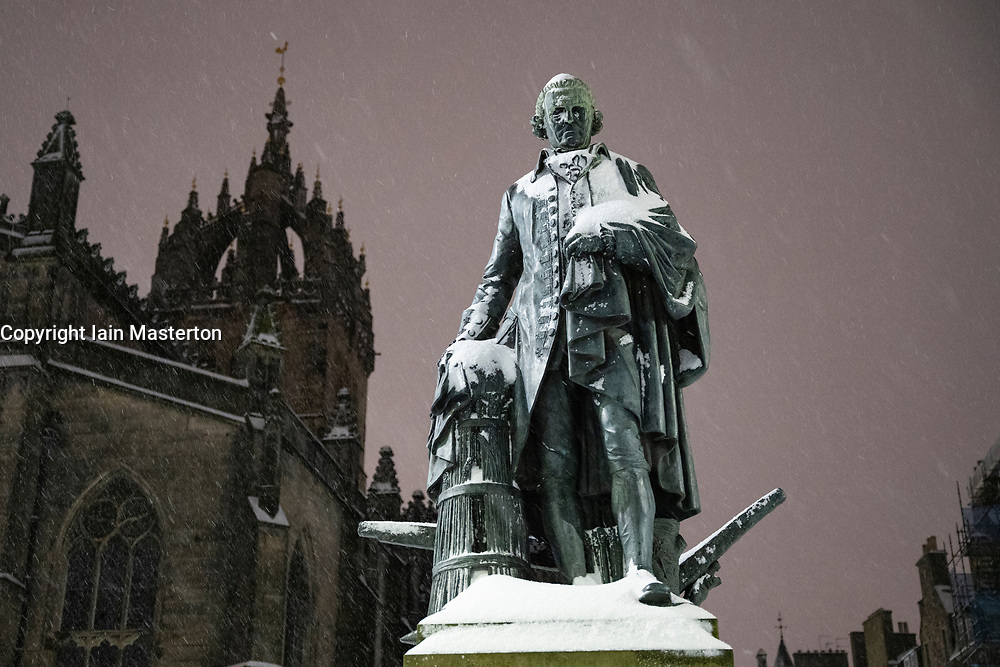 Edinburgh, Scotland, UK. 10 Feb 2021. Big freeze continues in the UK with heavy overnight and morning snow in the city. Pic; Statue of Adam Smith covered in snow  on the Royal Mile.  Iain Masterton/Alamy Live news