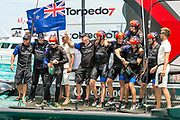 The Great Sound, Bermuda, 26th June 2017. Emirates Team New Zealand win race nine to win the America's Cup. Helmsman Peter Burling and trimmer Blair Tuke prepare to spray Moet Champagne in celebration.
