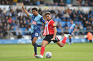 Lincoln City's Tyler Walker (17) and Wycombe Wanderers Darius Charles (21)  during the EFL Sky Bet League 1 match between Wycombe Wanderers and Lincoln City at Adams Park, High Wycombe, England on 7 September 2019.