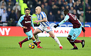 Huddersfield Town's Aaron Mooy evades Pedro Obiang of West Ham United during the Premier League match between Huddersfield Town and West Ham United at the John Smiths Stadium, Huddersfield, England on 13 January 2018. Photo by Paul Thompson.