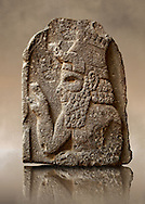 Late Hittite (Aramaean) Basalt funereal Steel with a relief sculpture of a man from 9 - 8th Cent B.C, excavated from Um-Shershuh, Syria.  Istanbul Archaeological Museum Inv. No 7786..<br />  <br /> If you prefer to buy from our ALAMY STOCK LIBRARY page at https://www.alamy.com/portfolio/paul-williams-funkystock/hittite-art-antiquities.html  - Type -  Shershuh   - into the LOWER SEARCH WITHIN GALLERY box. Refine search by adding background colour, place, museum etc<br /> <br /> Visit our HITTITE PHOTO COLLECTIONS for more photos to download or buy as wall art prints https://funkystock.photoshelter.com/gallery-collection/The-Hittites-Art-Artefacts-Antiquities-Historic-Sites-Pictures-Images-of/C0000NUBSMhSc3Oo