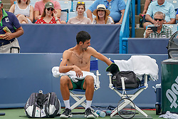 August 15, 2018 - Mason, Ohio, USA - Novak Djokovic (SRB) changes shirts during a break under the watchful eyes of fans during Wednesday's second round of the Western and Southern Open at the Lindner Family Tennis Center, Mason, Oh. (Credit Image: © Scott Stuart via ZUMA Wire)