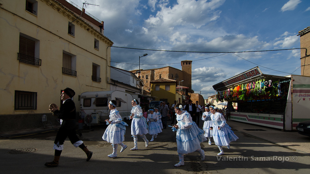 The group of 'danzantes' dancing at the streets of Cetina during sunset.