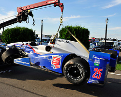 Justin Wilsons car is towed to the garage following a crash with Sage Karam. Sage Karam injured in a crash on August 23rd, 2015, at Pocono Raceway in Long Pond.
