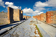 Street of Pompeii archaeological site. .<br /> <br /> If you prefer to buy from our ALAMY PHOTO LIBRARY  Collection visit : https://www.alamy.com/portfolio/paul-williams-funkystock/pompeii.html<br /> Visit our CLASSICAL WORLD HISTORIC SITES PHOTO COLLECTIONS for more photos to buy as buy as wall art prints https://funkystock.photoshelter.com/gallery-collection/Classical-Era-Historic-Sites-Archaeological-Sites-Pictures-Images/C0000g4bSGiDL9rw