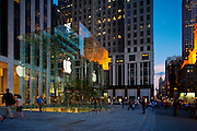 New York City: Sunset at the glass Apple store on Fifth Avenue