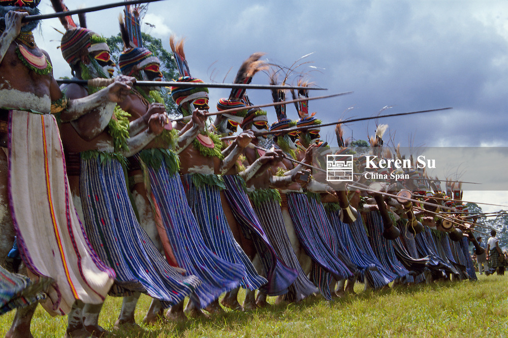 Highlands warriors marching performance at Sing Sing Festival, Mt. Hagen, Papua New Guinea
