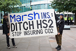 Climate activists from HS2 Rebellion hold a banner in front of two fellow activists who scaled the the Tower Place West building in the City of London in protest against the involvement of insurance company Marsh in the HS2 high-speed rail project on 2nd September 2021 in London, United Kingdom. Marsh insure subcontractors working on HS2.
