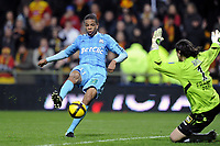 FOOTBALL - FRENCH CHAMPIONSHIP 2010/2011 - L1 - RC LENS v OLYMPIQUE MARSEILLE - 3/04/2011 - PHOTO JEAN MARIE HERVIO / DPPI - LOIC REMY (OM) / VEDRAN RUNJE (RCL)