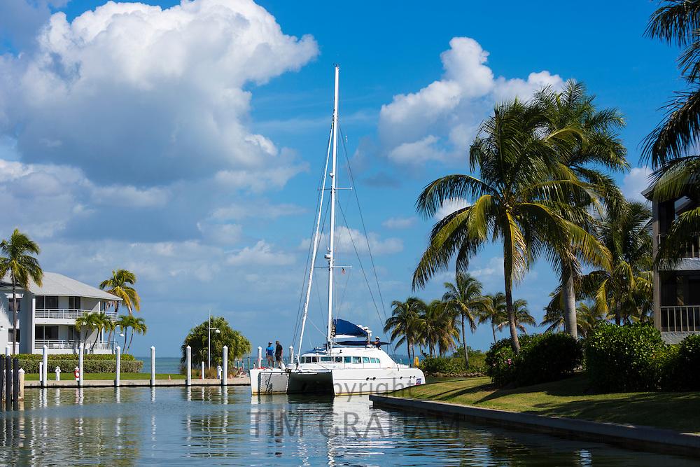 Luxury catamaran yacht sailing into port at upmarket South Seas Island Resort on Captiva Island in Florida, USA