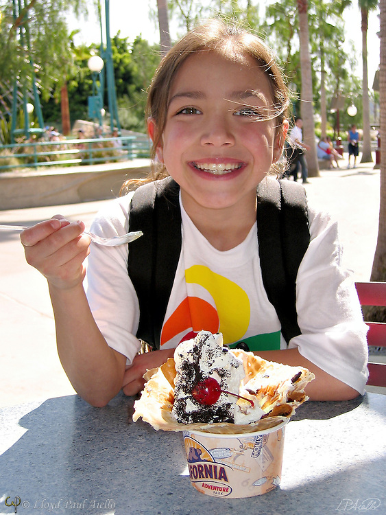 AJ ( age 8) smiles in anticipation of ice cream on a warm California day.