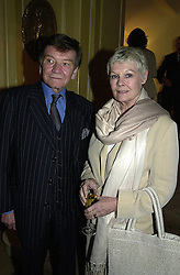 Actress DAME JUDI DENCH and her husband MR MICHAEL WILLIAMS, at a party in London on 24th February 2000.OBO 22