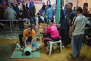Jan 24, 2014 - Chiang Mai, Thailand - <br /> <br /> Nine Year Old Muay Thai Fighter<br /> <br />  Focus received a massage from his trainer before his fight at the Thapae Muay Thai Stadium in Chiang Mai. PETCHFOGUS SITTHAHARNAEK, 9, aka Focus is the top fighter for his age and weight in Chiang Mai. He has begun fighting older, heavier opponents to continue to improve his skills. Fighters are typically paid 1000 baht (0) per fight.<br /> ©Exclusivepix
