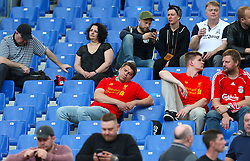 A Liverpool fan takes a nap in the stands ahead of the UEFA Champions League, Semi Final, Second Leg at the Stadio Olimpico, Rome.