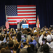 Former President Bill Clinton addresses the audience with Florida Democratic gubernatorial candidate Charlie Crist, second from left, Carole Crist, left, and running mate Annette Taddeo, second from right, attend a campaign event, Monday, Nov. 3, 2014, in Orlando, Fla. Crist, a former Florida Republican governor, is running against Republican Florida Gov. Rick Scott.  (AP Photo/Alex Menendez)