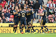 Son Heung-Min (2nd l) of Tottenham Hotspur celebrates with his teammates after scoring his teams 1st goal. Premier league match, Stoke City v Tottenham Hotspur at the Bet365 Stadium in Stoke on Trent, Staffs on Saturday 10th September 2016.<br /> pic by Chris Stading, Andrew Orchard sports photography.