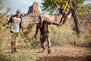 SHOT 10/14/16 5:02:22 PM - Tossing horseshoes on the White Rim trip. The White Rim is a mountain biking trip in Canyonlands National Park just outside of Moab, Utah. The White Rim Road is a 71.2-mile-long unpaved four-wheel drive road that traverses the top of the White Rim Sandstone formation below the Island in the Sky mesa of Canyonlands National Park in southern Utah in the United States. The road was constructed in the 1950s by the Atomic Energy Commission to provide access for individual prospectors intent on mining uranium deposits for use in nuclear weapons production during the Cold War. Four-wheel drive vehicles and mountain bikes are the most common modes of transport though horseback riding and hiking are also permitted.<br /> (Photo by Marc Piscotty / © 2016)