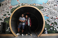 Michee´ Mande, 16, and Autumn-Reign Richardson, 16, helped create a mural, under the guidance of an artist, at the Brookline Teen Center. The pair did most of their drawing freehand on the piece, which is an artistic take on a futuristic map of Brookline.<br /> Wicked Local staff photo / Kate Flock