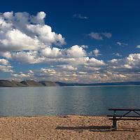 Sandy beach and turquoise waters of Bear Lake, Idaho.