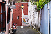 Murals decorate Rocha alley in Tlacotalpan, Veracruz, Mexico. The tiny town is painted a riot of colors and features well preserved colonial Caribbean architectural style dating from the mid-16th-century.