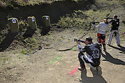 Bill Dragoo (left), Val (center) and Gary Kepple (right) shooting Crossman air rifles during pit competition at 2010 Rawhyde Adventure Rider Challenge