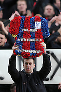 Crystal Palace Ultra fan holds up a memorial of Crystal Palace fan 'Paul Nixon' who passed away 21 years ago today, the fan was famous for being kick by Manchester United player Eric Cantonta Barclays Premier League match, Crystal Palace v Norwich city at Selhurst Park in London on Saturday 9th April 2016. pic by John Patrick Fletcher, Andrew Orchard sports photography.