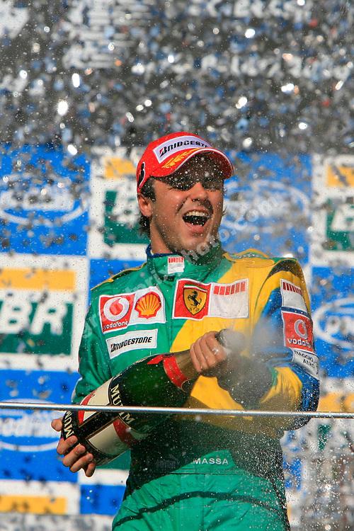 Felipe Massa (Ferrari= sprays the champagne on the podium after the 2006 Brazilian Grand Prix at Interlagos. Photo: Grand Prix Photo