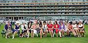© Licensed to London News Pictures. 21/06/2012. Ascot, UK Women pose for a picture on benches. Ladies Day at Royal Ascot 21st June 2012. Royal Ascot has established itself as a national institution and the centrepiece of the British social calendar as well as being a stage for the best racehorses in the world.. Photo credit : Stephen Simpson/LNP