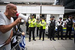 © Licensed to London News Pictures. 04/09/2018. London, UK. A large police presence watches over outside Labour Party headquarters in London ahead of a National Executive Committee meeting. The Labour Party's ruling body is expected to vote on whether to adopt, in full, the IHRA (International Holocaust Remembrance Alliance) definition of anti-Semitism. Photo credit: Ben Cawthra/LNP