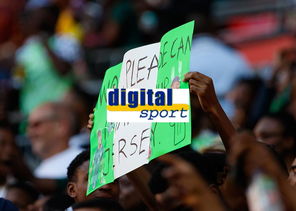 Football - 2018 International Friendly (pre-World Cup warm-up) - England vs. Nigeria<br /> <br /> A fan holds a placard up asking for Alex Iwobi (Nigeria) shirt at Wembley Stadium.<br /> <br /> COLORSPORT/DANIEL BEARHAM