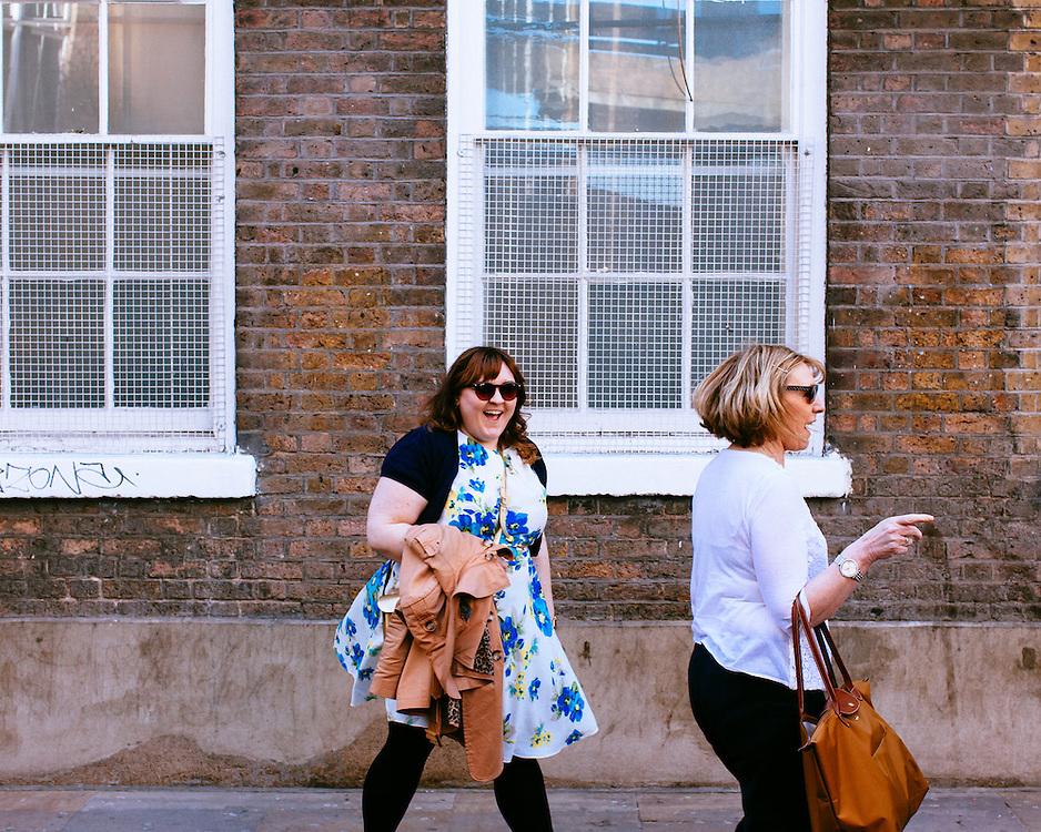 Female shoppers wondering around on Brick Lane